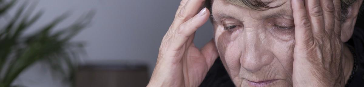 Panorama of despair senior woman having headache